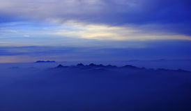 Morning Mist at Tropical Mountain Range, Thailand Stock Photos