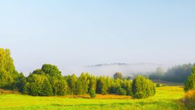 Morning mist in the valley, time-lapse stock video footage