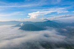 Morning Mist in the Volcanoes Valley. Indonesia. Morning in the Bromo Tengger Semeru National Park. Dense fog in the valley Royalty Free Stock Images
