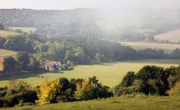 Morning mists over an English autumn landscape. Low morning mists over a Chiltern landscape in Oxfordshire, England, in early autumn Stock Images