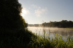 Morning misty fog rise flow river water Stock Photo