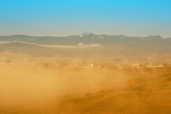 Morning fog. Morning misty hills and mountains with snow royalty free stock images