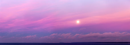 Morning moon in the sky. Above the sea, panorama Stock Photography