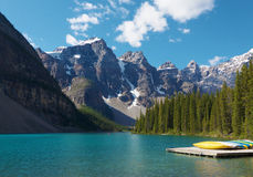 Morning on the Moraine Lake. Banff (Alberta, Canada), in Rocky Mountains. The beautiful azure color of the lake is faithfully reproduced on this photograph Stock Images