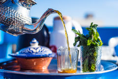 Morning moroccan tea. The tea in morocco is the most consumed hot drink in morocco, and the tradition moroccan tea pot is a mythic design object used nowadays in Royalty Free Stock Photography