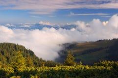 Morning mountain fog in summer stock photos