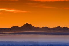 Morning mountain skyline. Early morning fog in the valley and skyline of the Alaska Range in Sunset Stock Photos