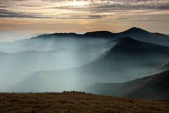 Morning mountain with waves of fog. Morning mountain landscape with waves of fog on valleys Stock Photos