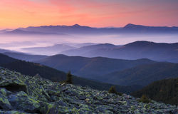 Morning in mountains. Landscape with mountains under morning sky with clouds Royalty Free Stock Image