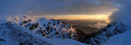 Morning mountaintop panorama. Sunrise near Omu peak, Bucegi Mountains, Romania Stock Photos