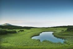 Morning near small mountainous pond Stock Photos