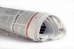 Morning news. A news paper rolled up with white background Stock Image