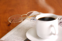 Morning news with coffee Stock Image