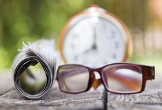Morning news - newspaper and eyeglasss stock images