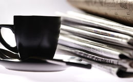 Morning newspapers and a cup of coffee Stock Images