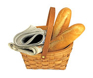 Morning newspapers and fresh bread in basket Royalty Free Stock Photo