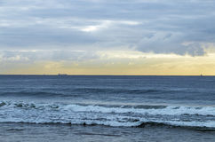 Morning Ocean Against Cloudy Sky with Ships on Horizon Royalty Free Stock Photos