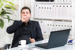 Morning in the office. Bored businessman in the office royalty free stock photography