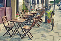 In the morning old outdoor cafe waiting for visitors Stock Photos