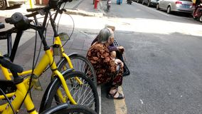 Old women sitting on the street chatting stock video