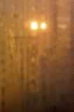 Morning orange dew droplets on window Stock Photo