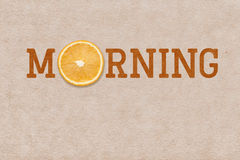 Morning orange sign. Morning word printed on vintage paper with orange slice inside Royalty Free Stock Photos