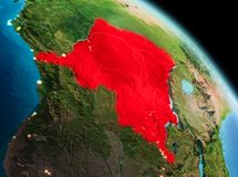 Morning over Democratic Republic of Congo on Earth. Satellite morning view of Democratic Republic of Congo highlighted in red on planet Earth. 3D illustration Royalty Free Stock Images