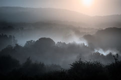 Morning over the mountains. Misty morning of hilly area with ray of light royalty free stock image