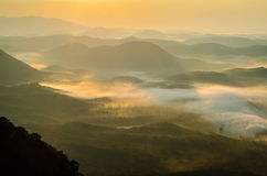 Morning over the valley in South Carolina. Morning light illuminates the foggy valley in the Appalachian Mountains of South Carolina near Greenville Stock Photos
