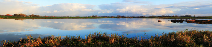 Morning panorama at the lake. Huge stitched panorama of a lake in a rural landscape Stock Photo