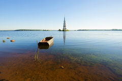 Morning panorama of the Uglich reservoir with the flooded bell tower and the old boat. Kalyazin, Russia Royalty Free Stock Image