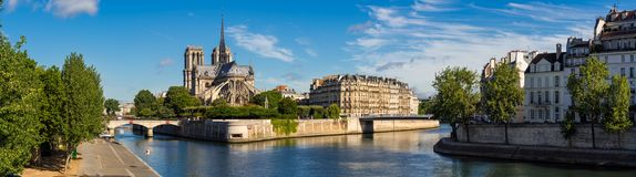 Morning panoramic view of Notre Dame de Paris and the Seine River. Paris, France. Morning panoramic view of Notre Dame de Paris cathedral and banks of the Seine Royalty Free Stock Image
