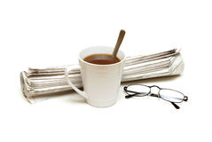 Morning Paper. The morning paper with a coffee and reading glasses Royalty Free Stock Photos