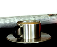 Morning Paper. Espresso Cup and newspaper, isolated on black and white with spacve for copy Stock Photo