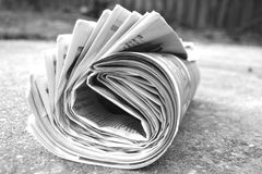 Morning paper. Newspaper on driveway royalty free stock photos