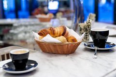 A morning in Paris. Coffee and croissants, a morning everyday treat on a marble bar Royalty Free Stock Photography