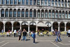 Morning on piazza San Marco, Venice, Italy. Venice, Italy - April 6, 2017: Morning on piazza San Marco. There are not many tourists yet, the street cafes are Stock Photo