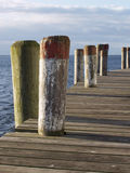 Morning Pier - Vertical. Early light illuminates pier Royalty Free Stock Photos