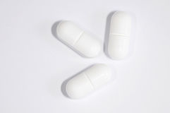 Morning after pill. Tree white pills isolated against white background royalty free stock photography