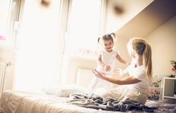 Morning playing. Mother and daughter. stock photos