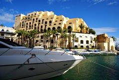 Morning at Portomaso Marina. PORTOMASO HARBOR,ST' JULIAN' S, ISLAND OF MALTA , EUROPE - NOVEMBER 8, 2014. Morning at Portomaso Marina area ,with luxury hotels Royalty Free Stock Photo