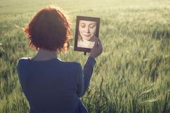 Morning portrait of beautiful girl in green field Stock Image