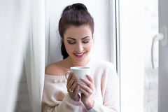 Morning portrait of young beautiful woman with cup of coffee Stock Photo
