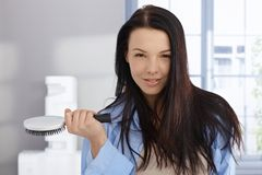Morning portrait of young woman with hairbrush Royalty Free Stock Photos