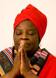 Morning prayer. Black lady in prayer early in the morning Stock Image