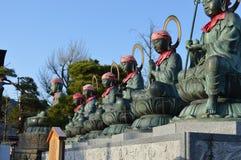 Morning prayer. Buddha statue s in the morning sunlight Stock Photography