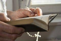 Morning prayer of grandmother Royalty Free Stock Photo