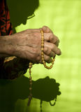 Morning prayer of old woman Stock Photos