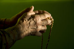 Morning prayer of old woman Stock Images