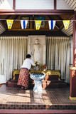 Morning preparation of buddhist altar. Royalty Free Stock Image